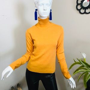 Brooks Brothers turtle neck sweater.